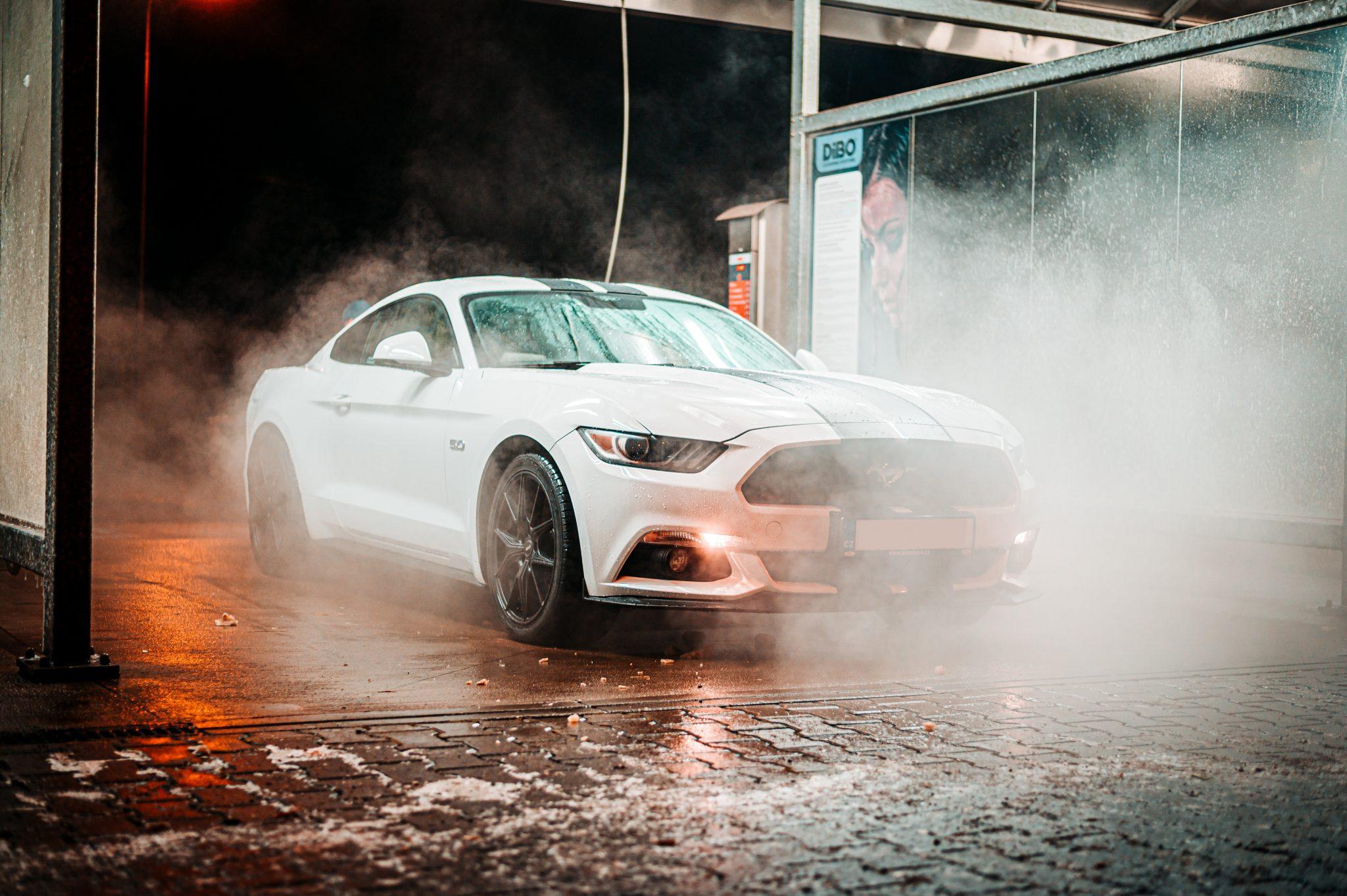 car wash white car at night