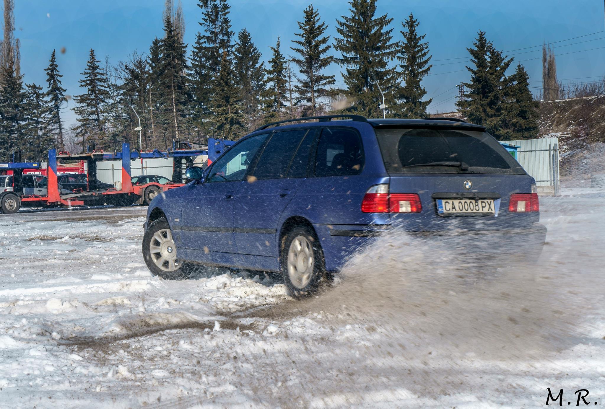 car throwing snow